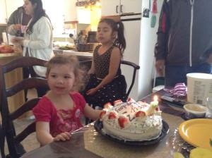 Izzy ready to blow out her birthday candle