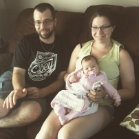 my brother Mike, wife Sarah and baby