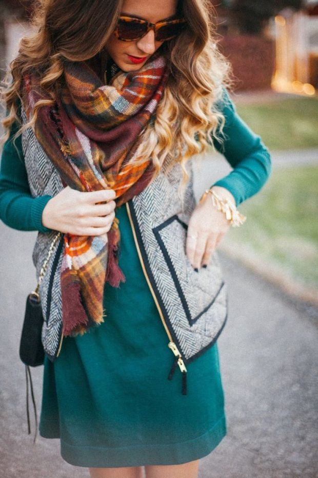 This plaid blanket scarf, with a quilted vest, and green dress