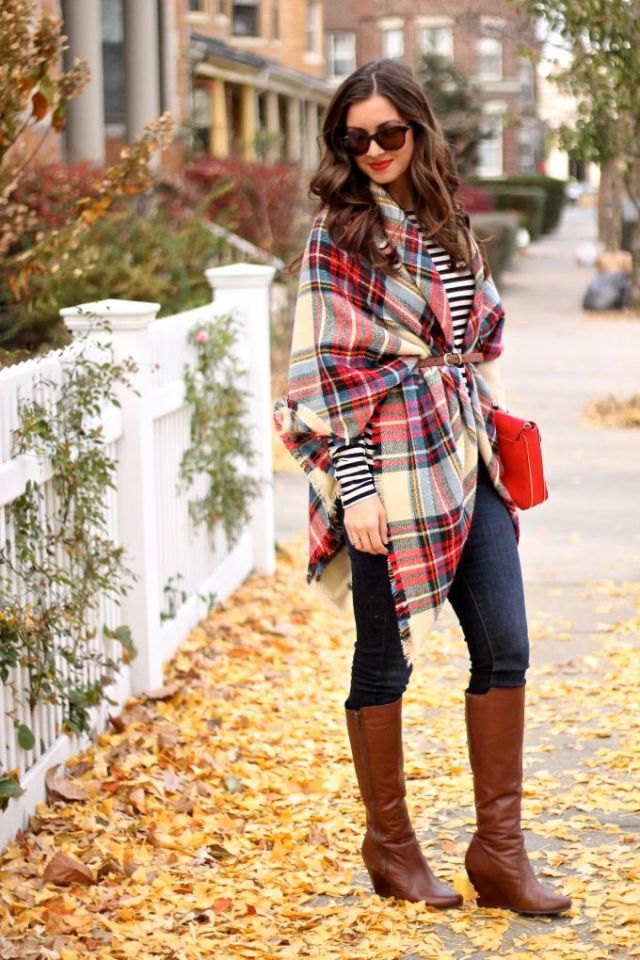 This is a great example of the right way to wear a blanket scarf as a shawl.  And her hair is pretty much perfect!