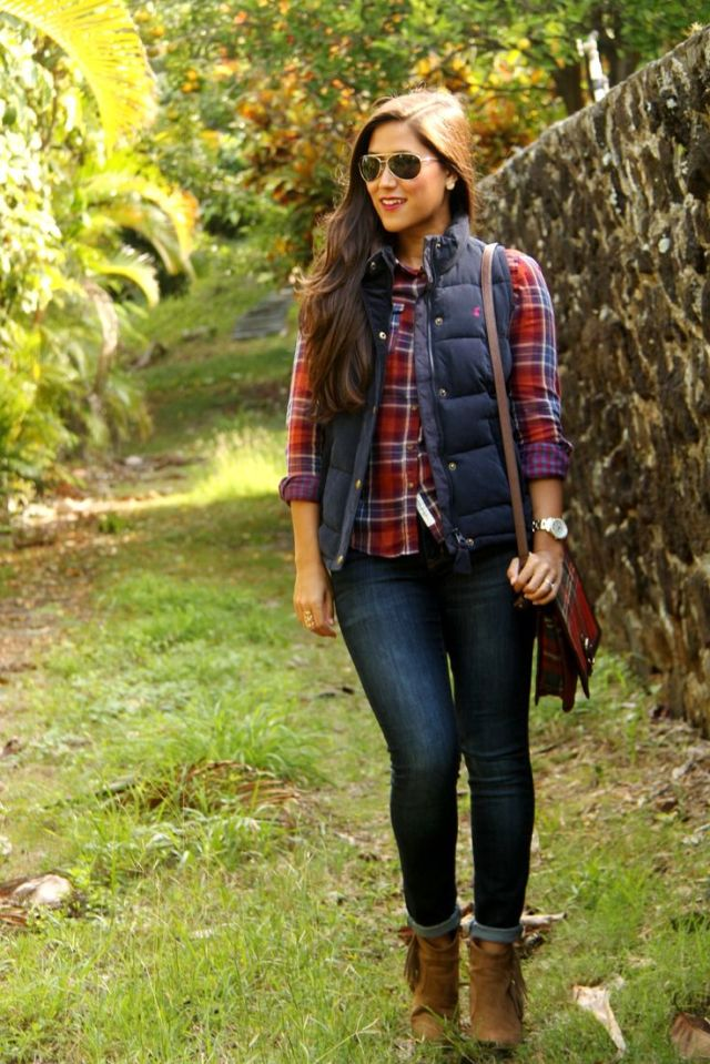 Love this entire look.  Dark, skinny jeans, booties, plaid shirt, puffy vest, and long loose curls
