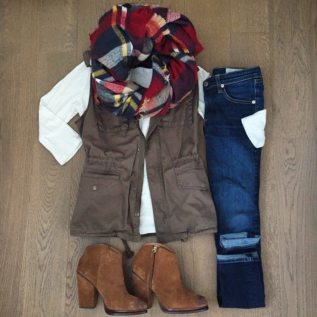 Gorgeous plaid scarf, dark cuffed jeans, neutral long-sleeved tee, cute military-style vest, and cowboy-inspired booties