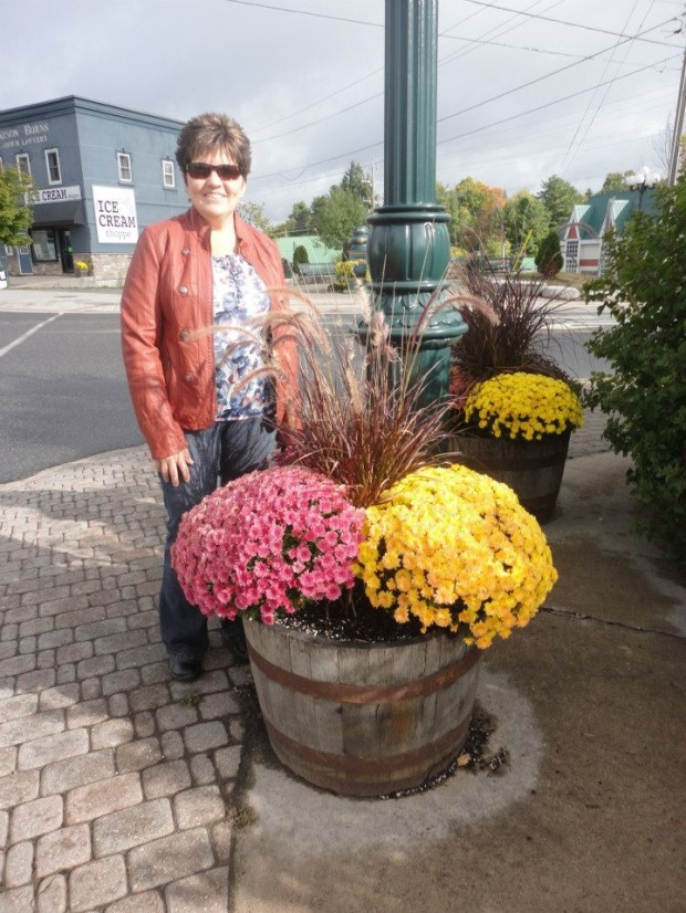 My pretty Mom with some mums.  Bracebridge trip.