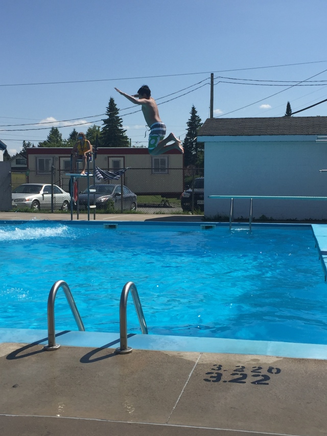 My son leaping off the diving board