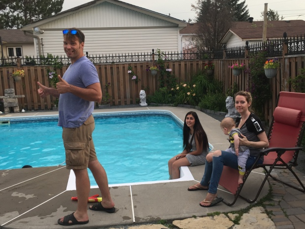 Family by the pool